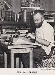 Frank Herbert at his typewriter in 1958