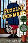 Puzzled Indemnity | Hall, Parnell | Signed First Edition Book