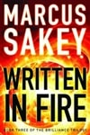 Written in Fire | Sakey, Marcus | Signed First Edition Trade Paper Book